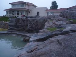 artificial rock wall/ infinity pool