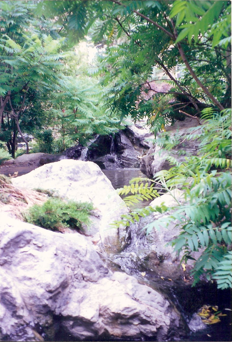 Artificial rock waterfall and pond