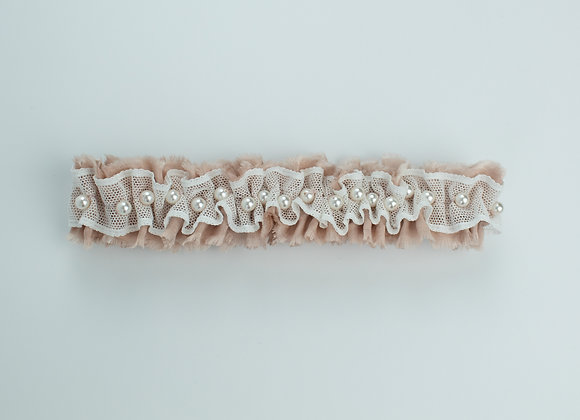 Blush silk and white net Nottingham lace bridal garter decorated with white pearls throughout
