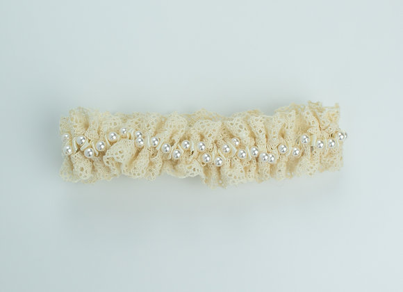 Ivory crochet lace bridal garter embellished with white pearls throughout