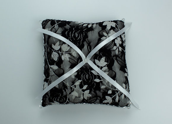 Black and white vintage floral lace wedding ring pillow with 4 white ribbons coming out of the center