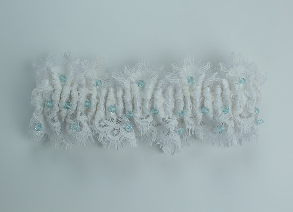 White lace wedding garter embellished with azure crystals throughout