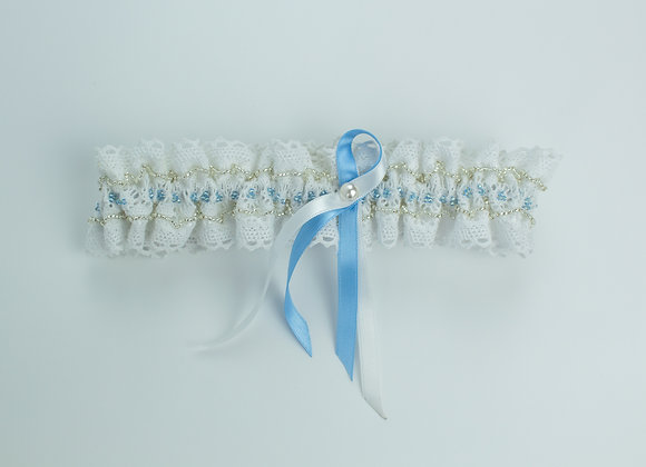 White cotton lace bridal garter embellished with silver and blue seed beads throughout and a white and blue bow in the middle
