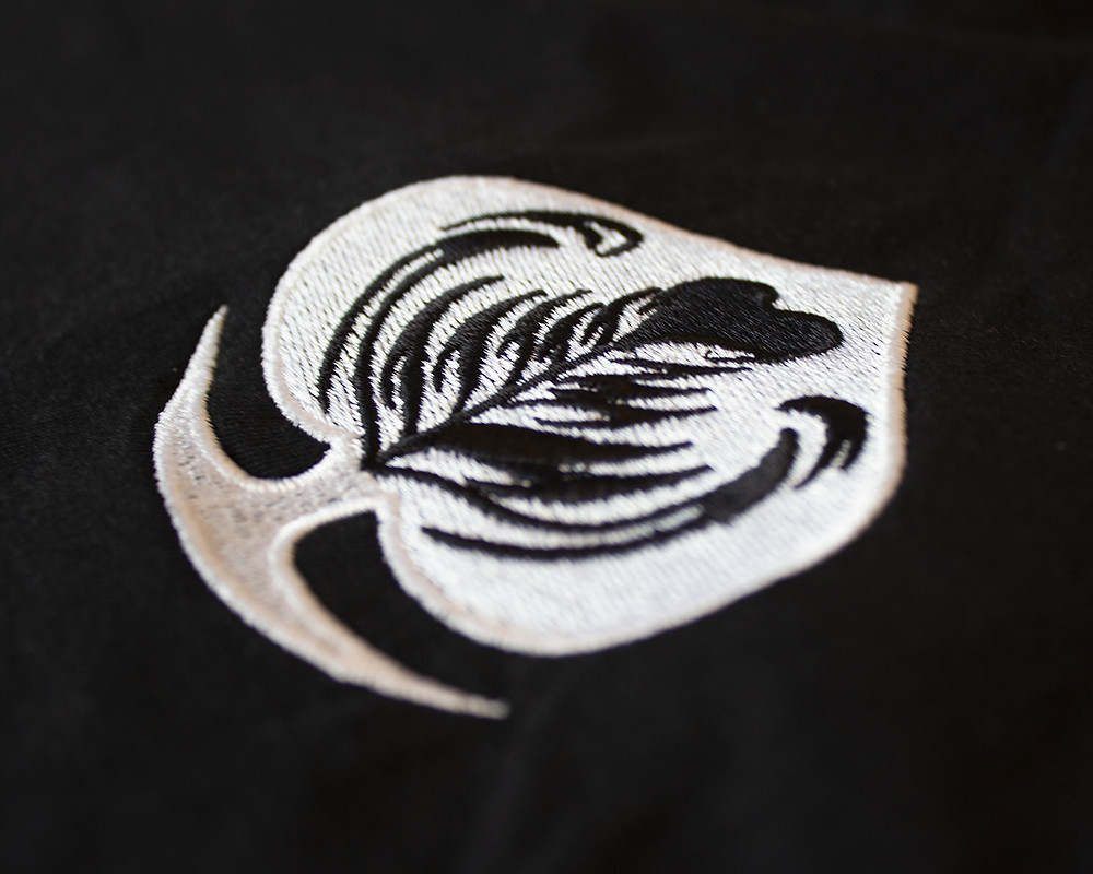 Latte spade detail on the black Ace of Cafes embroidered tee by Great Lake Supply Co.