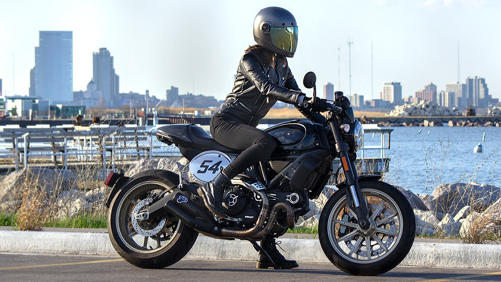 Motorcyclist at the ready mounted on a Ducati Scrambler