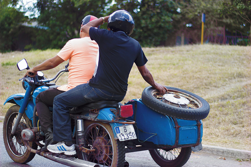 Vintage blue motorcycle with sidecar in Cuba