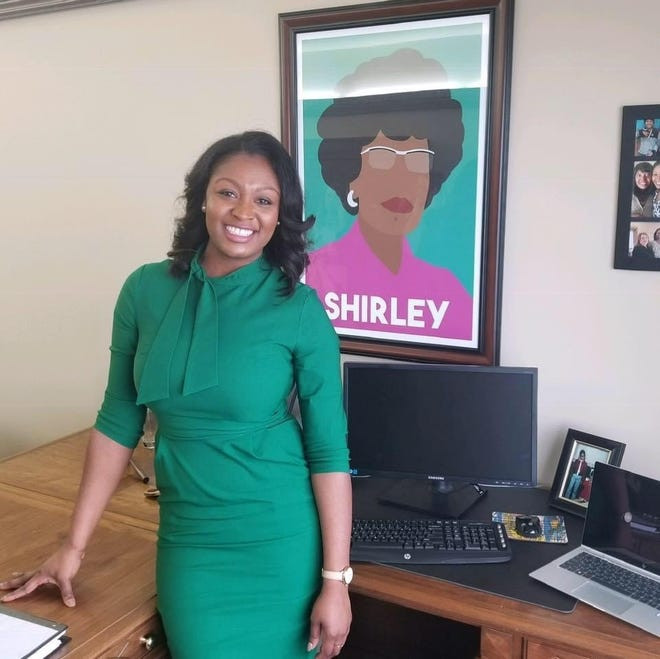 a pop-art portrait of her hero, 1972 candidate for the Democratic presidential nomination Chisholm, in her office for inspiration.