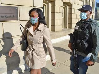 Armed citizens escort lawmaker into Michigan State Capitol