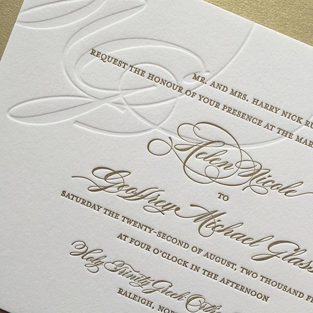 Love the simplicity of a large monogram blind letterpressed and cropped off the edge. Bold but simpl