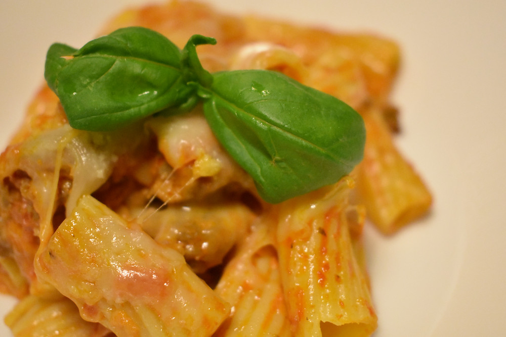Belly-filling baked ziti on a white dish.