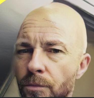 Luke Kearney shaved head.jpg