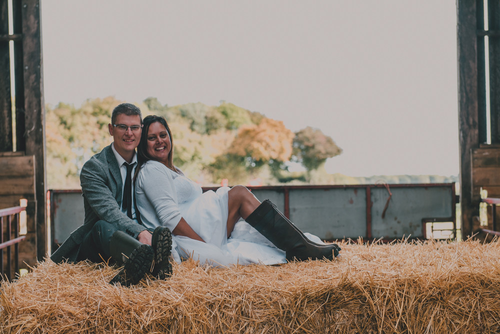 Couple on hay bale