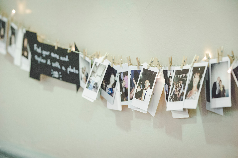 names replaced with polaroids - wedding breakfast idea