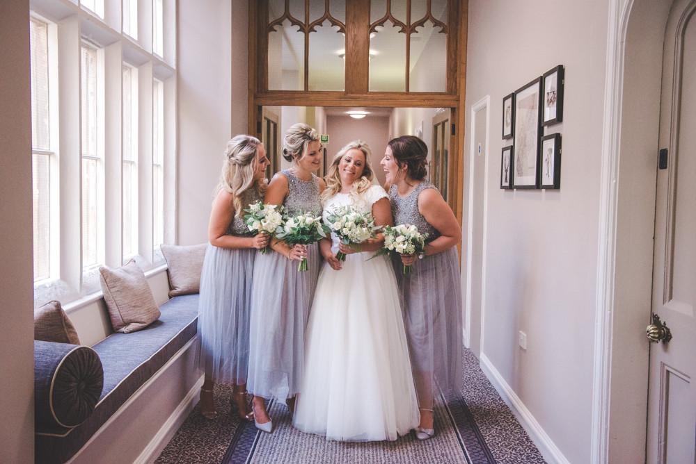 Bride and bridesmaids in Tortworth Court interior