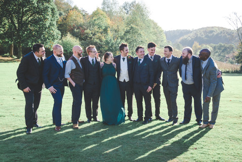 group photo of the grooms friends in the grounds of tortworth court gloucestershire