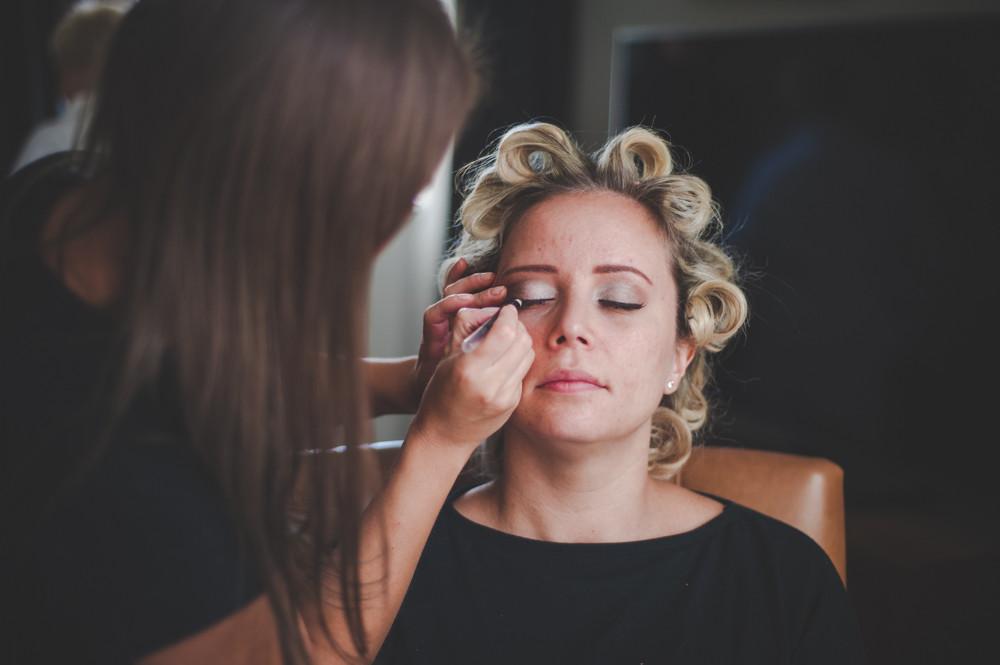 Bride having eye make up applied by wedding make up artist