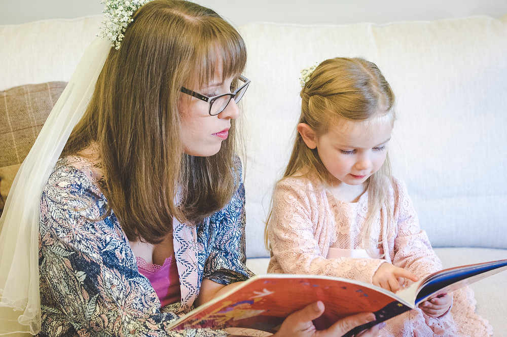 Bride reading stories to young member of family