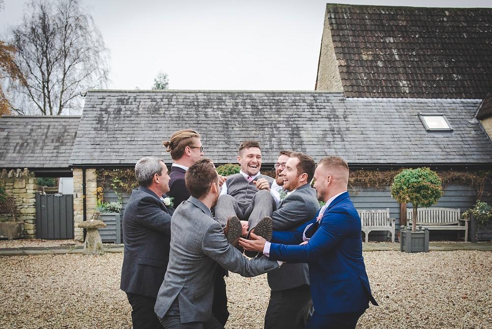 groom being thrown in air