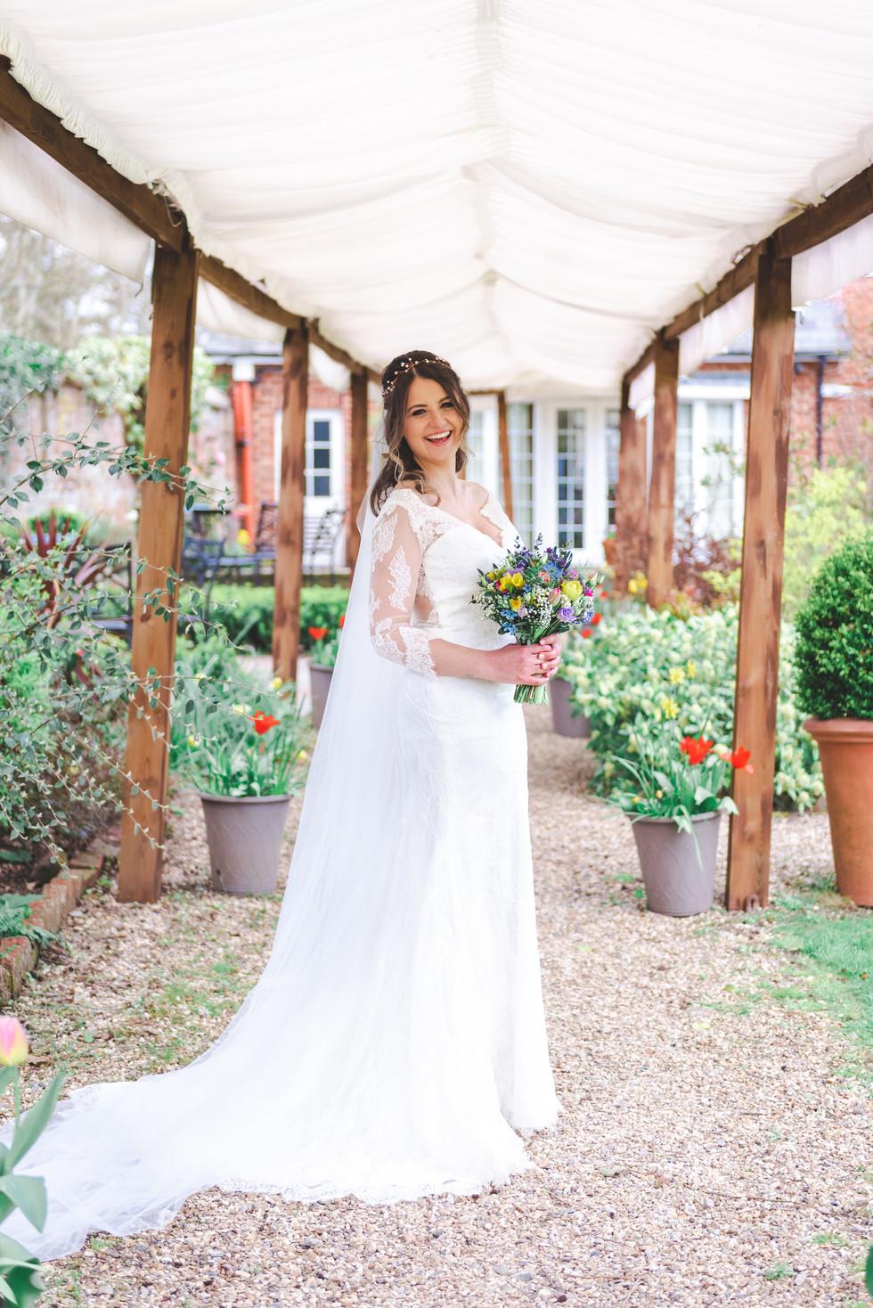 Bride under marquee archway