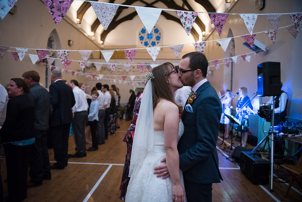 Sneaky kiss bride and groom ceilidh dance
