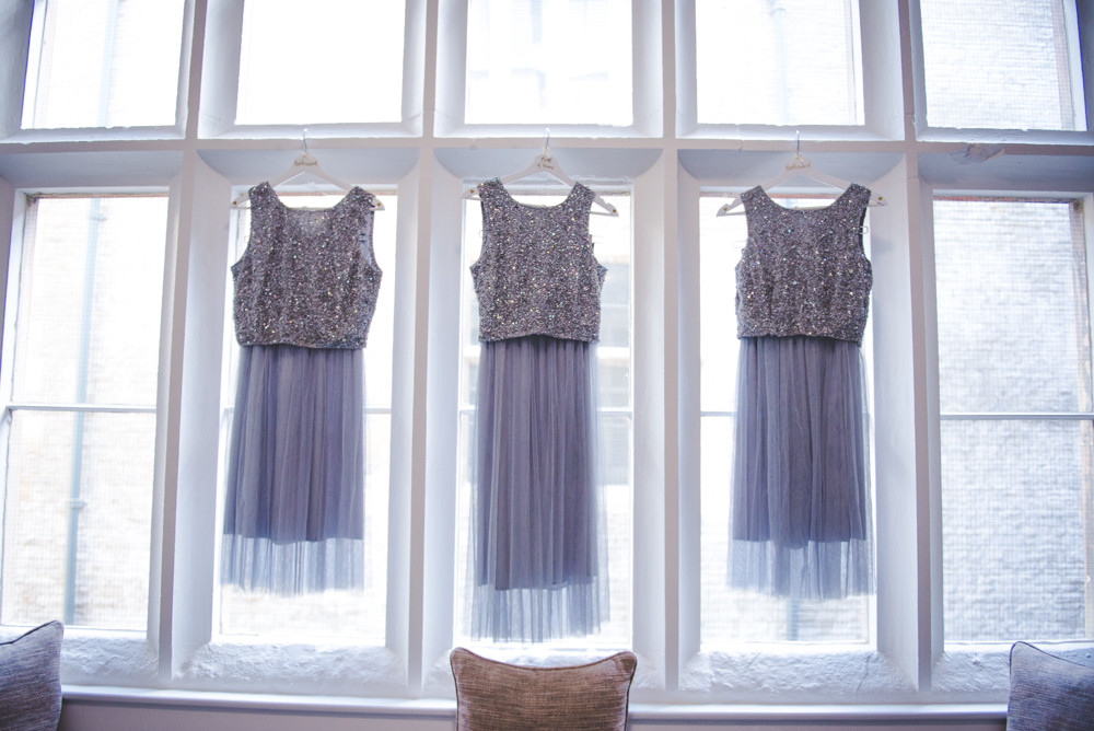 Bridesmaid dresses hanging in windows of Tortworth Court