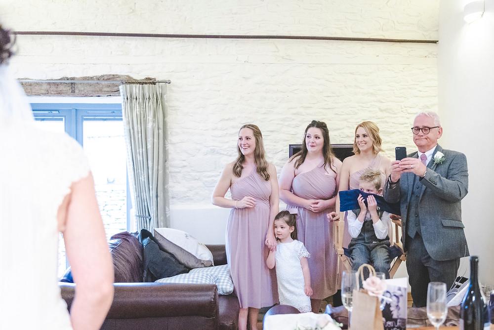 bridesmaids first look at bride