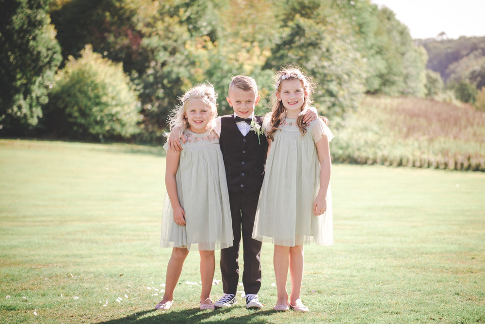 Page boy and flower girls in Tortworth Court grounds