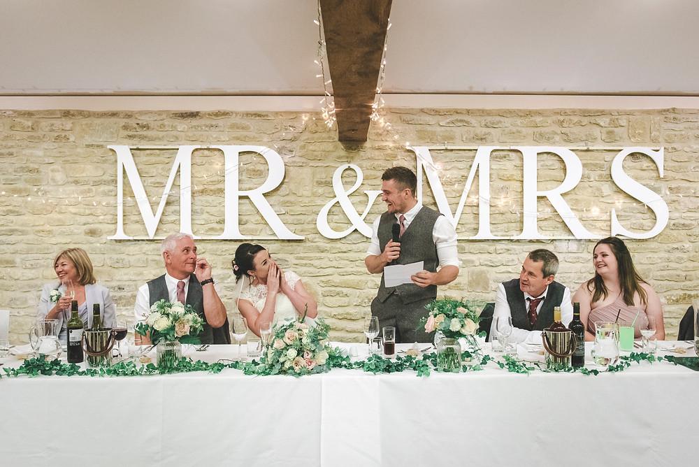 groom speech bride cheering