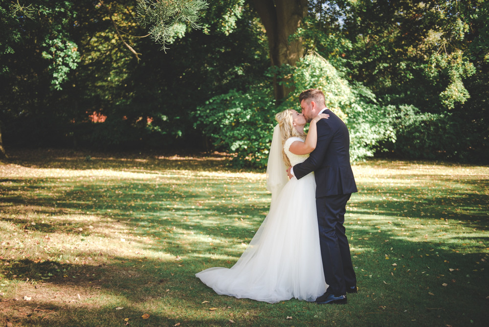 Bride and groom in tortworth court grounds