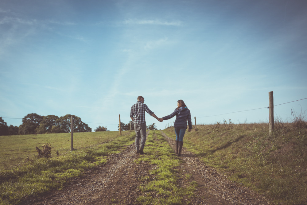 Couple walk up farm track