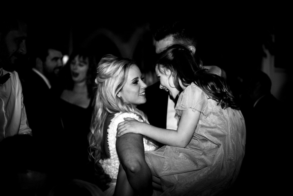 bride groom and daughter dancing