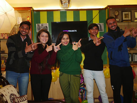 cast members of wise studio project double tick posing in a success party