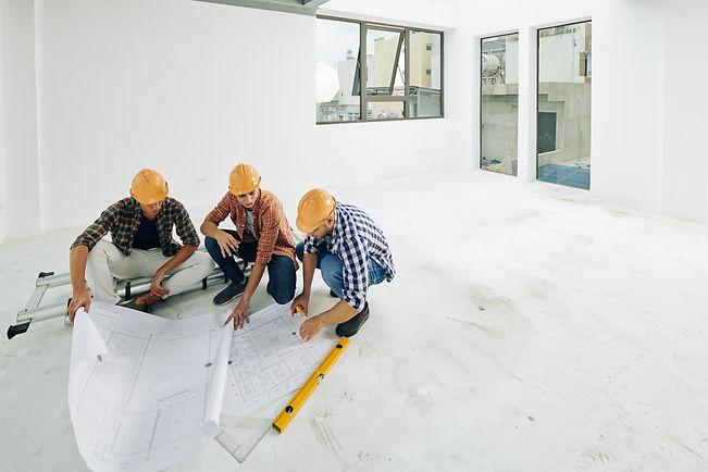 builders-checking-blueprints-DBRC7YF.jpg