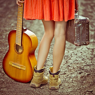 Woman traveling with a guitar