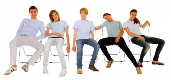 People slouching in folded chairs