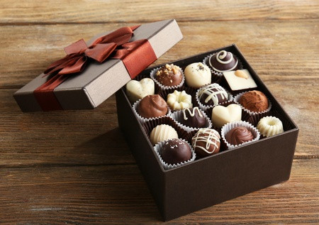 Gift box with bow on open top, box of assorted chocolates