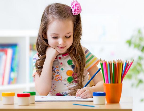 Cute little preschooler child drawing at