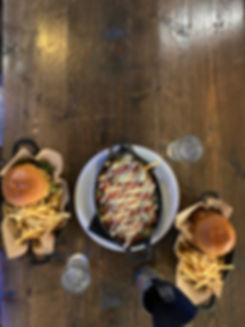 Burgers and dirty fries from above.jpeg