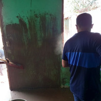 Cleaning the mud off walls - Helping in Honduras