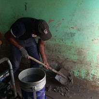 Cleaning out the mud - Helping in Honduras