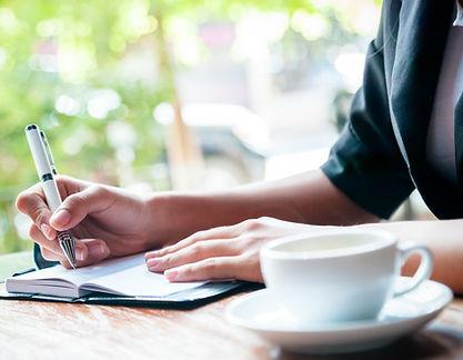 woman writing an ediing