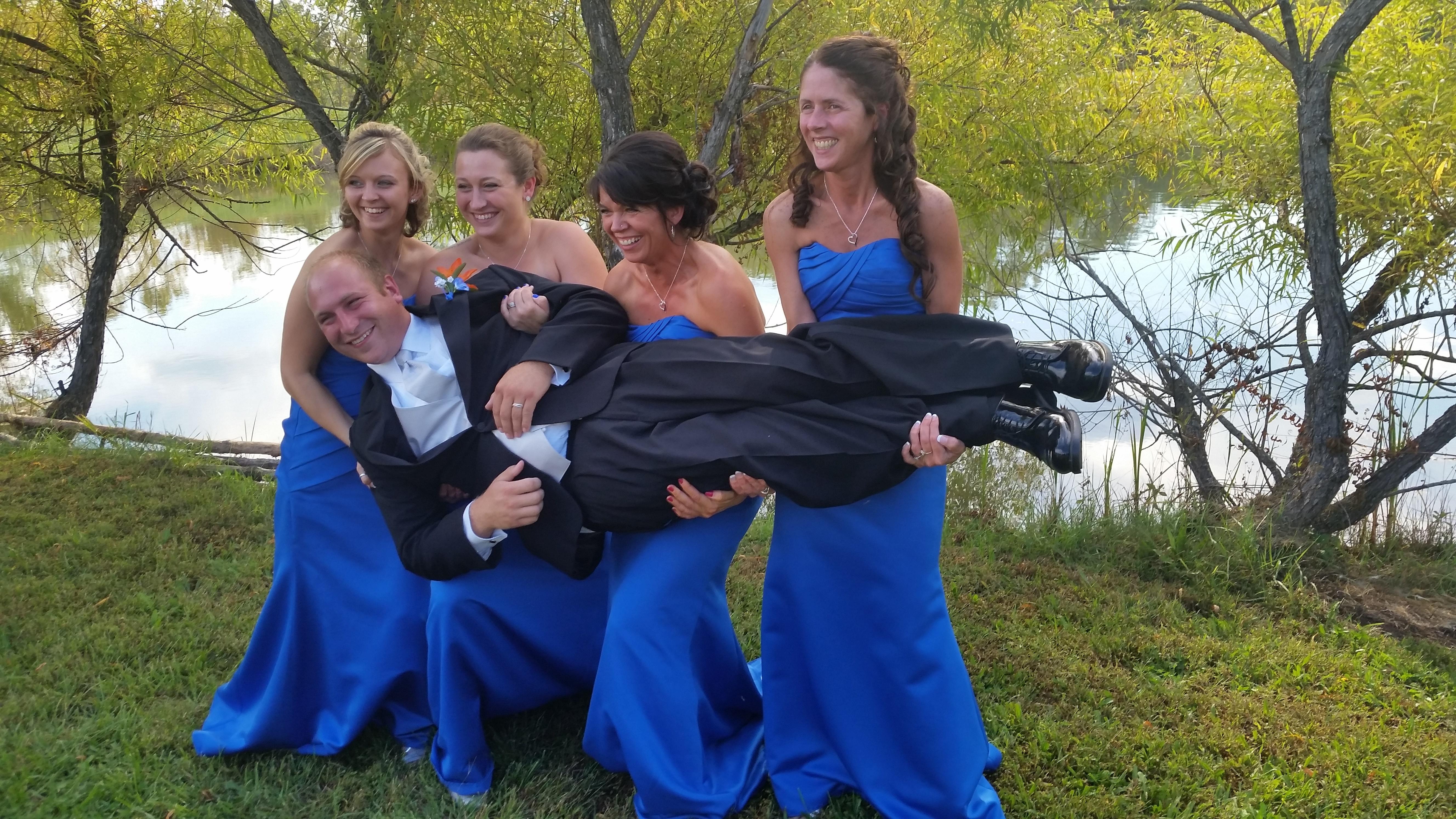 Wedding bridesmaids holding Groom