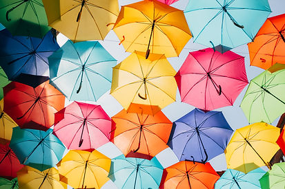Canopy of colourful open umbrellas