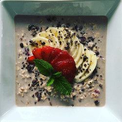 Strawberry overnight oats with soy milk, banana, and cocoa nibs