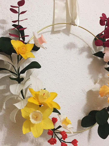 Hibiscus, Daffodil with small orange flowers, red ecualyptus and leaves $150