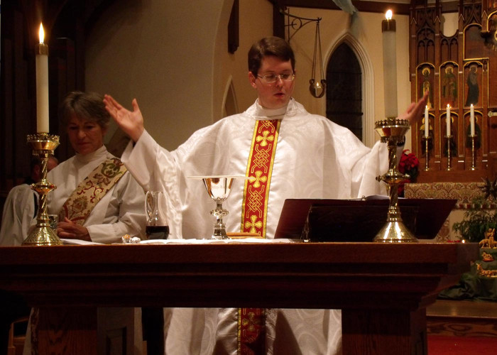 Father Bret saying Mass at St. Johns
