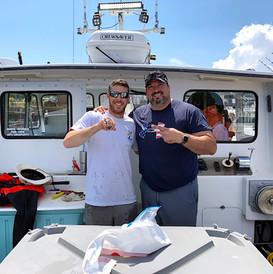 Joe Andruzzi and Captain Frank on Sambuca II
