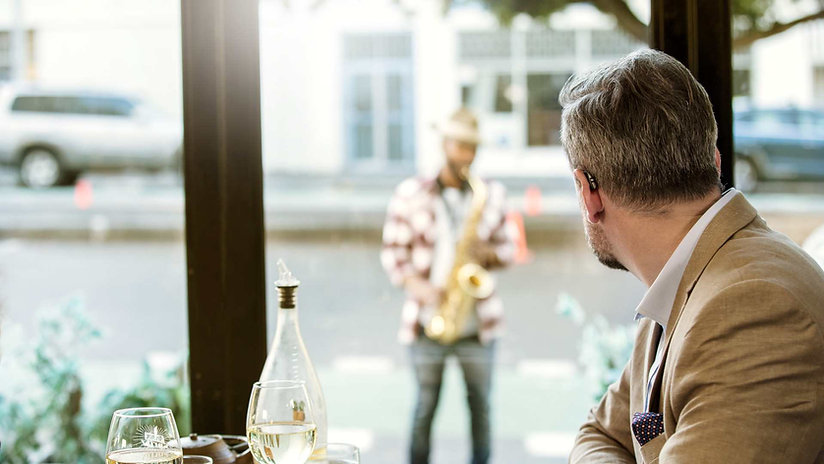 man-looking-at-background-noise-in-cafe-environment-1920--1080.jpg