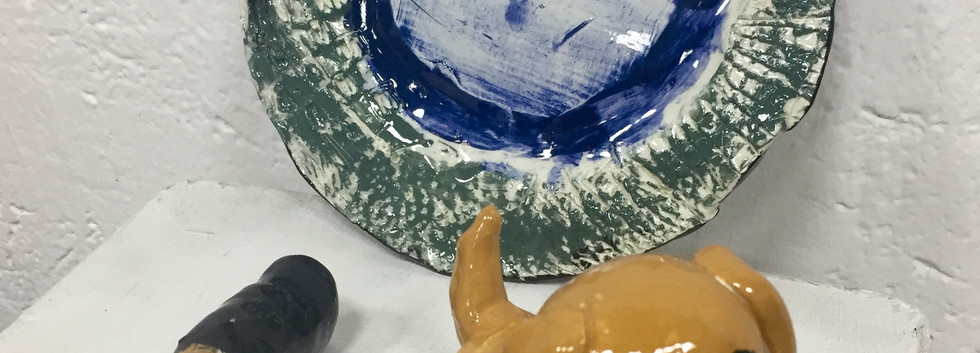 Stamp, Plate, and Puppy in Clay