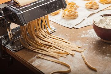 the-fresh-pasta-and-machine-on-kitchen-t